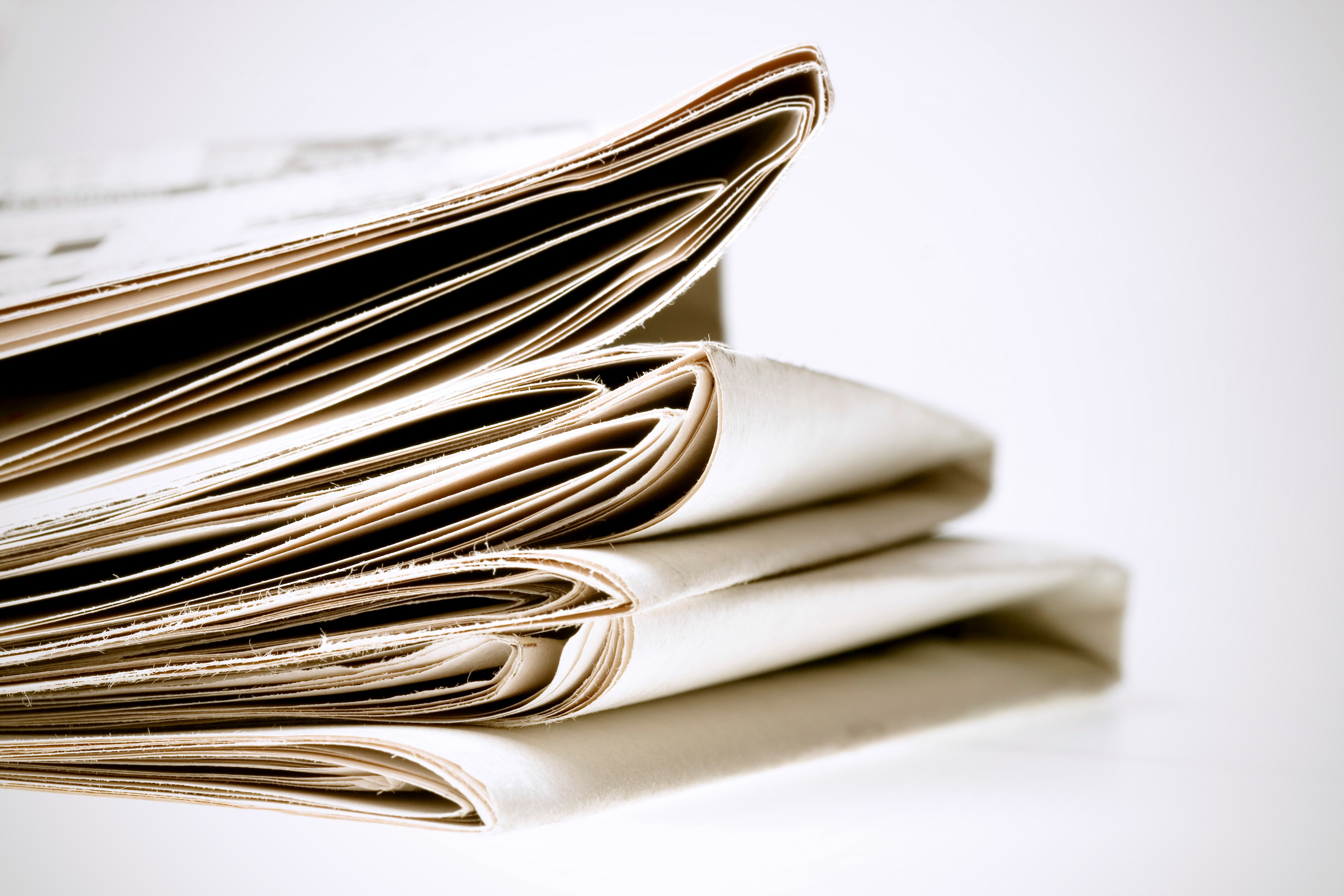 Image of a pile of newspapers (free image)